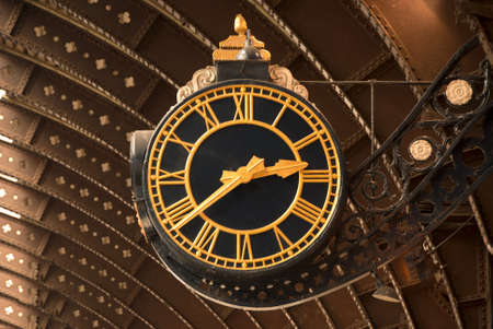 An Antique Black and Gold Railway Station Clock