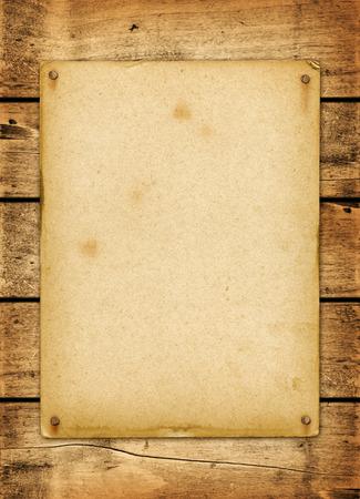 Foto de Blank vintage poster nailed on a wood board panel - Imagen libre de derechos