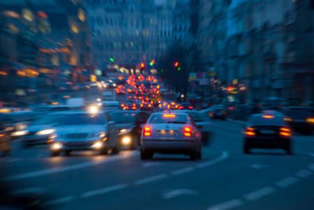 Urban night traffic, blurred with zoom effect