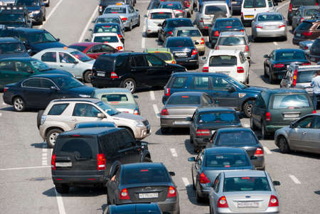 Traffic jam on the road, a lot of cars which go towards each other and to the different directions
