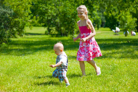 Photo for Children playing on the lawn in the park - Royalty Free Image