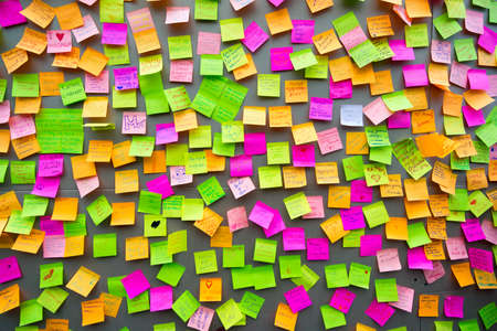 Photo for Many different colors paper notes on the wall - Royalty Free Image