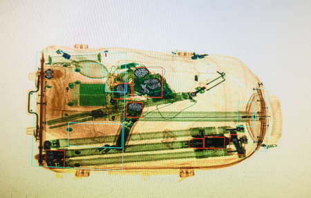 Photo pour Real X-ray image of the suitcase at the airport security service - image libre de droit