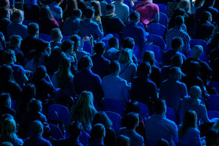 Foto per Audience listens to the lecturer at the business conference, back view, blue tones - Immagine Royalty Free