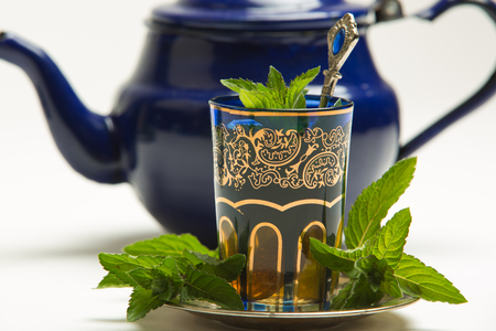 Photo for Traditional Arab mint tea in a traditional cup with mint leaves - Royalty Free Image