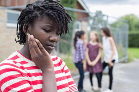 Foto de Sad Teenage Girl Feeling Left Out By Friends - Imagen libre de derechos