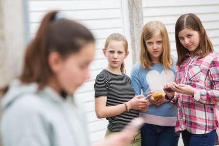 Foto de Pre Teen Girl Being Bullied By Text Message - Imagen libre de derechos