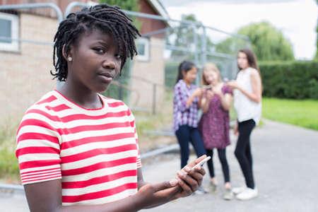 Foto de Portrait Of Teenage Girl Being Bullied By Text Message - Imagen libre de derechos