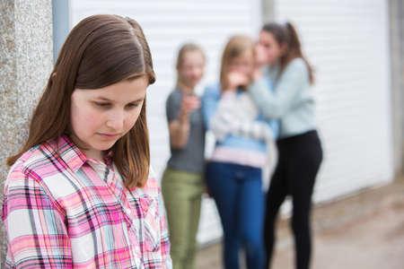 Foto de Sad Pre Teen Girl Feeling Left Out By Friends - Imagen libre de derechos
