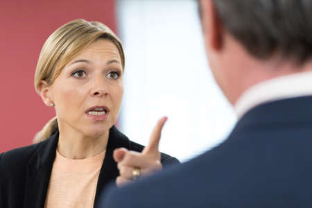 Photo for Aggressive Businesswoman Shouting At Male Colleague - Royalty Free Image