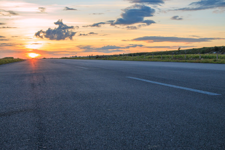 Photo for Rural road in the sunset - Royalty Free Image