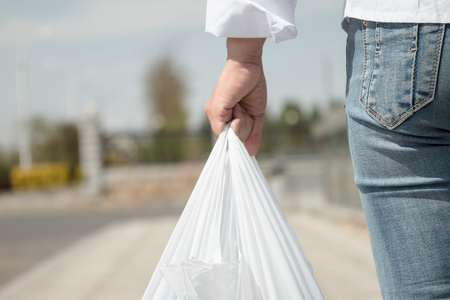 Photo for Woman holding a plastic bag - Royalty Free Image