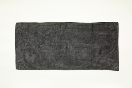 Photo for Black towel on a gray background - Royalty Free Image