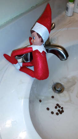 Photo for Elf on the Shelf poops chocolate kisses - Royalty Free Image