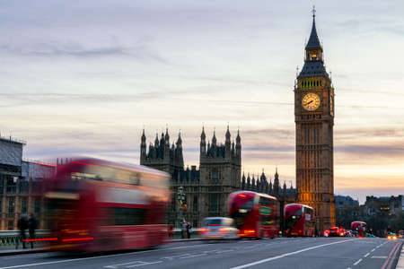Photo pour The Big Ben, House of Parliament and double-decker bus blurred in motion, London, UK - image libre de droit