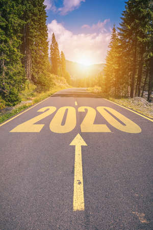 Photo pour Empty asphalt road and New year 2020 concept. Driving on an empty road in the mountains to upcoming 2020 and leaving behind old 2019. Concept for success and passing time. - image libre de droit