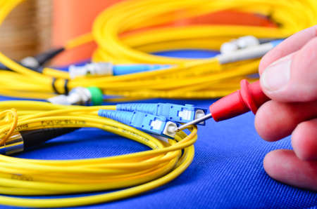 Photo for Network engineer testing fiber optic cables and connections - Royalty Free Image