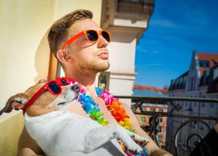 Photo for jack russell dog and owner having a siesta under the sun ,sun tanning with sunglasses, close and cozy together in love - Royalty Free Image