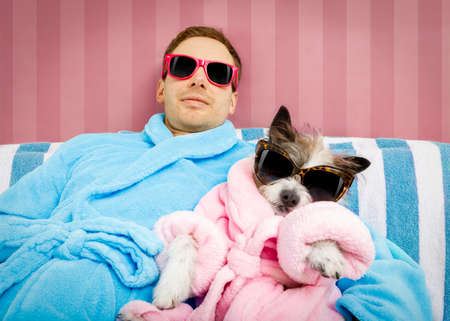 Photo pour cool funny couple of   poodle dog  and owner  both resting and relaxing in   spa wellness salon center ,wearing a  bathrobe and fancy sunglasses, - image libre de droit