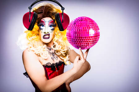 Photo for cool drag queen with spectacular makeup, glamorous stylish look, posing with   proud and  style for lgtb equality gay rights with disco ball - Royalty Free Image