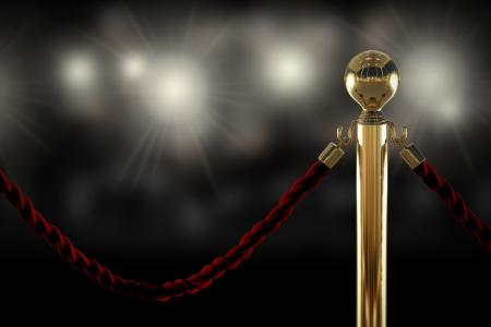 Photo pour Red velvet rope barrier close-up with flash light on background - image libre de droit