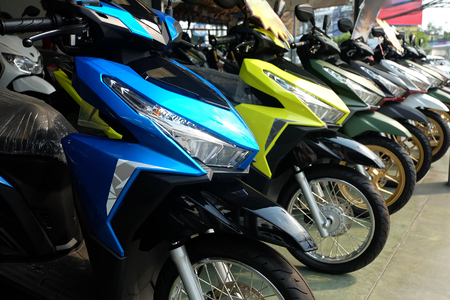 Photo for Many colorful motorcycles at the Showroom for sale - Royalty Free Image