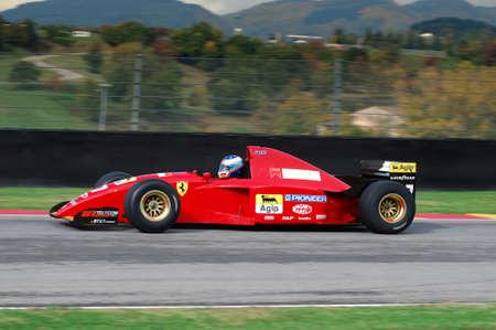 Photo for MUGELLO, IT, November, 2007: unknown run with Historic Ferrari F1 412 T2 ex Gherard Berger during Finali Mondiali Ferrari 2007 into the mugello circuit in italy - Royalty Free Image