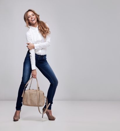 Foto de Beautiful happy woman holding a bag  - Imagen libre de derechos