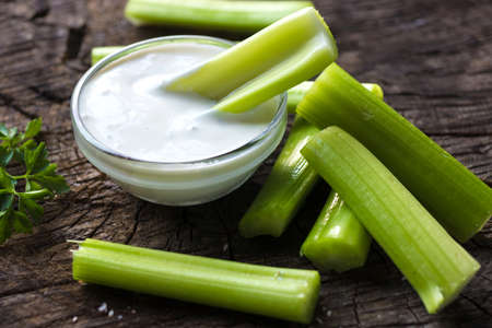 Photo for Celery sticks with dip - Royalty Free Image