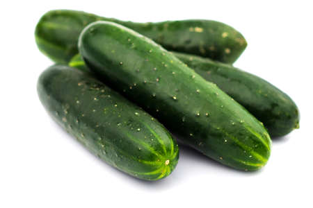 Photo pour Fresh cucumbers isolated on white - image libre de droit