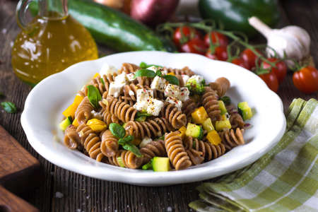 Photo for Whole wheat pasta with vegetables and feta - Royalty Free Image