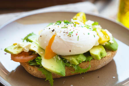 Photo for Sandwich with avocado and poached egg - Royalty Free Image
