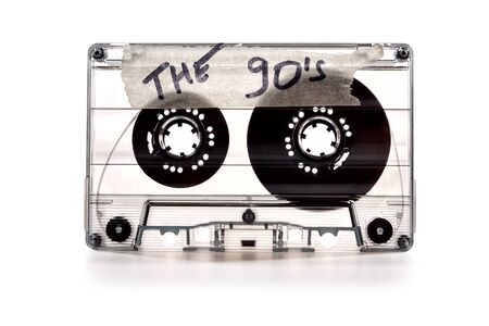Photo for vintage old film music cassette isolated on white background with the inscription the 90's, background music, music lovers - Royalty Free Image