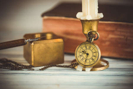 Photo for Pocket watch and candle - Royalty Free Image