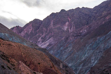 Photo for View of Iruya village and multicolored mountains in the surroundings at sunset, Salta province, Argentina, iruya - San Isidro - San Juan treeking - Royalty Free Image