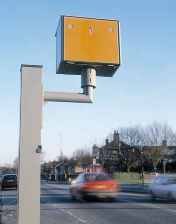 Photo pour Speed camera with speeding vehicle. - image libre de droit