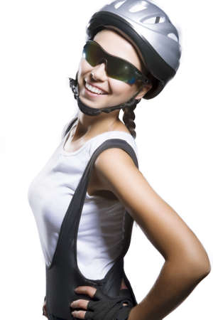 beautiful portrait of caucasian female bike athlete with brilliant smile wearing  professonal sportswear. isolated over pure white background. vetical shot
