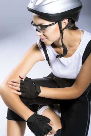 natural portrait of professional female caucasian bike athlete sitting and thinking. vertical image