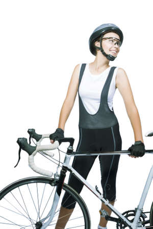portrait of young caucasian female athlete wearing professional clothing with bike. isolated on white background. vertical shot