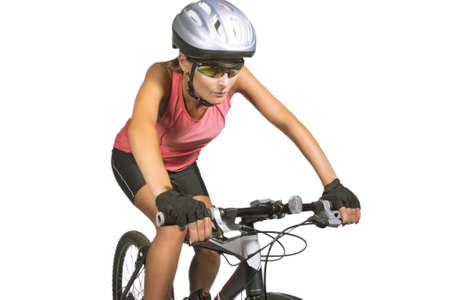 professional female cycling athlete riding mountain bike and equipped with professional bike gear isolated over white background. horizontal shot