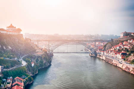 Photo pour Travel Ideas. Cityscape of Porto Across The Douro River in Portugal with Red Rooftops in Background. Horizontal Image - image libre de droit