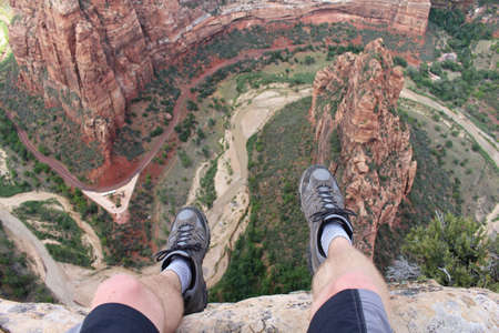 Photo pour First person perspective shot from a hiker sitting at the edge of a cliff at Angel's Landing in Zion National Park. - image libre de droit