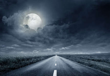 Foto de asphalt road night bright illuminated large moon - Imagen libre de derechos