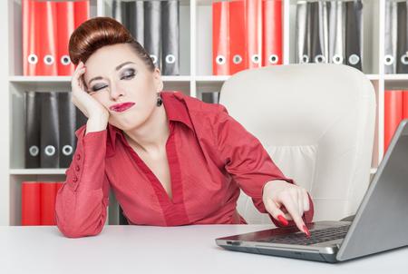 Foto de Boring business woman working at office with computer - Imagen libre de derechos