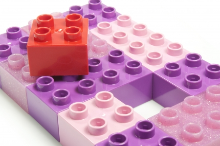 toy bricks of different colors joined together