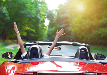Photo for Happy beautiful blond young woman driving a sports car - Royalty Free Image