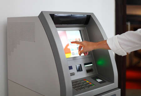 Foto per Man using banking machine. Close up - Immagine Royalty Free