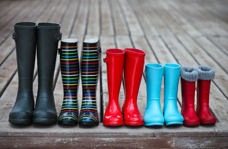 Photo pour Five pairs of a colorful rain boots. Family concept - image libre de droit