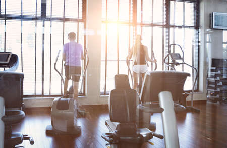 Foto per Healthy couple training on a treadmill in a sport centre - Immagine Royalty Free