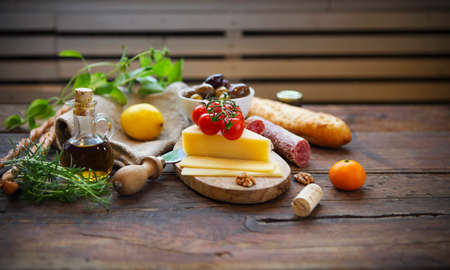 Photo for Italian food ingredients with olive oil on wooden background - Royalty Free Image